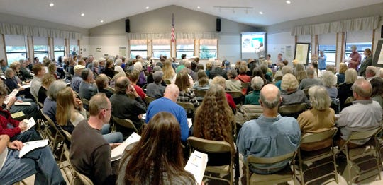Community members packed the Greater Hansville Community Center Monday night to hear about Pope Resource's plans to spray chemicals on 330 acres of its recently harvested timber land near Hansviille.