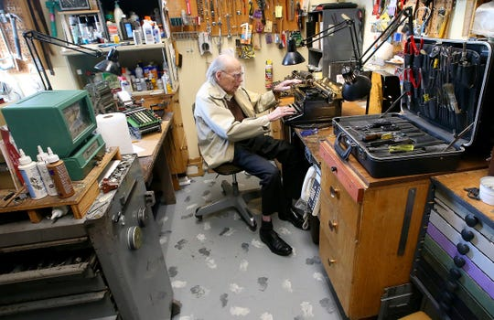 Bob Montgomery sits at his workbench in front of a Royal typewriter at Bremerton Office Machine Company in Bremerton shortly before his retirement in 2016.