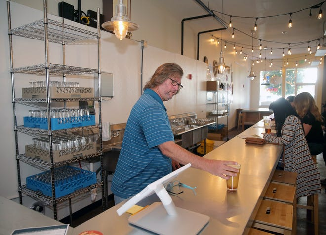 Local Boys Taproom co-owner  Bobby Holstein places a Hale's Ales, wee heavy Scotch ale on the counter. The grand opening for the business on Fourth Street and Pacific in Bremerton is September 14-16.