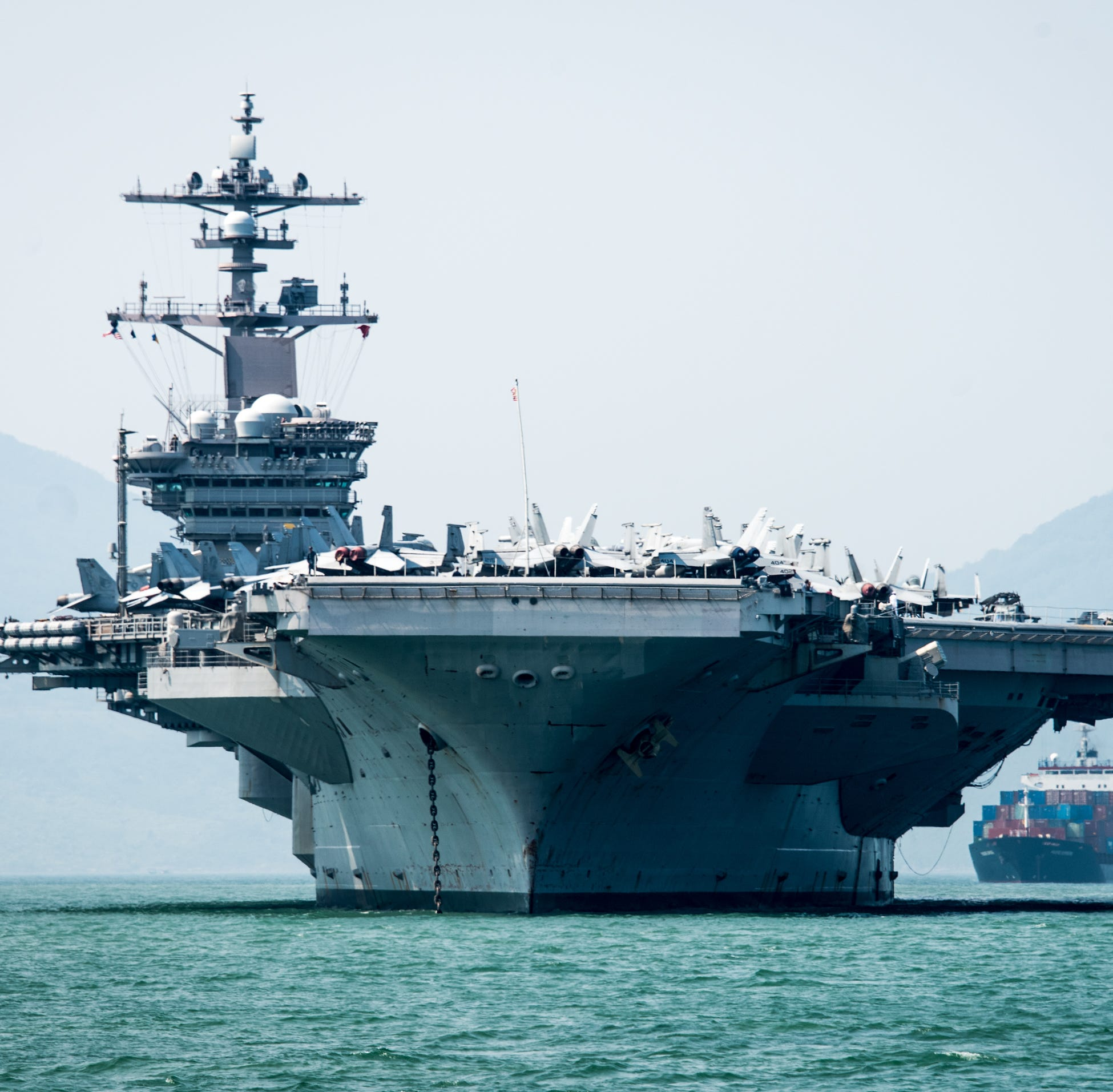 The aircraft carrier USS Carl Vinson (CVN 70) arrives in Da Nang, Vietnam, for a scheduled port visit March 5, 2018. The Carl Vinson Strike Group is in the Western Pacific as part of a regularly scheduled deployment.