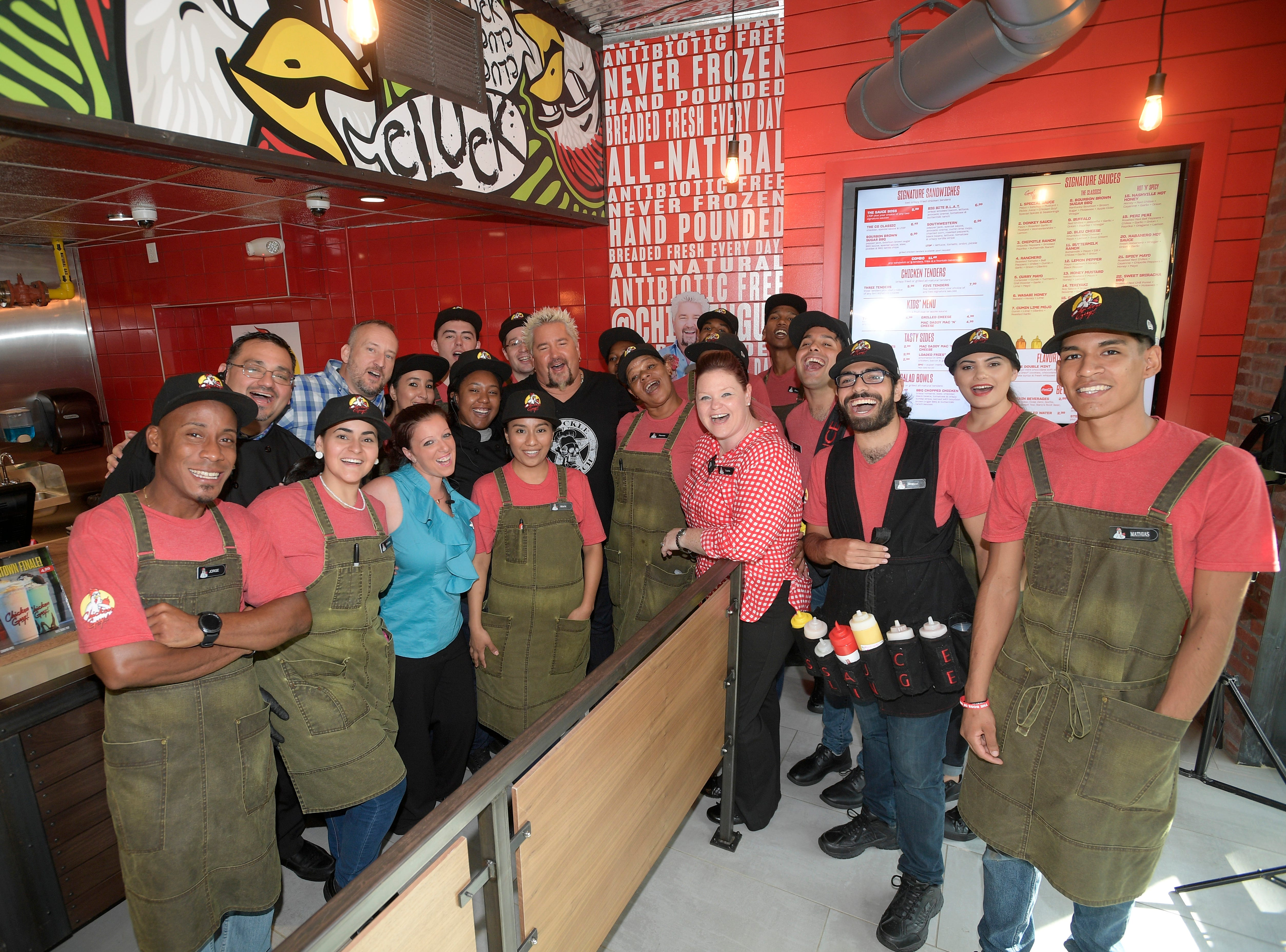 Chef Guy Fieri, center, was at Chicken Guy! at Disney Springs Monday for a special ribbon-cutting ceremony.