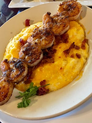 Darci Kropp, owner of Darci's Bacon Blues in Cape Canaveral, does not want dishes like this shrimp and grits delivered by DoorDash or any other service, because she fears the quality of her food will suffer.