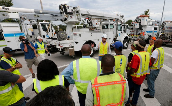 Wade Jollimore (center), Broward County distribution operations leader for Florida Power & Light Company discusses safety procedures with FPL employees and contractors before they leave for Walterboro, South Carolina.   More than 500 FPL employees and contractors left South Florida to help restore power to the Carolinas that are anticipated to be impacted by Hurricane Florence.