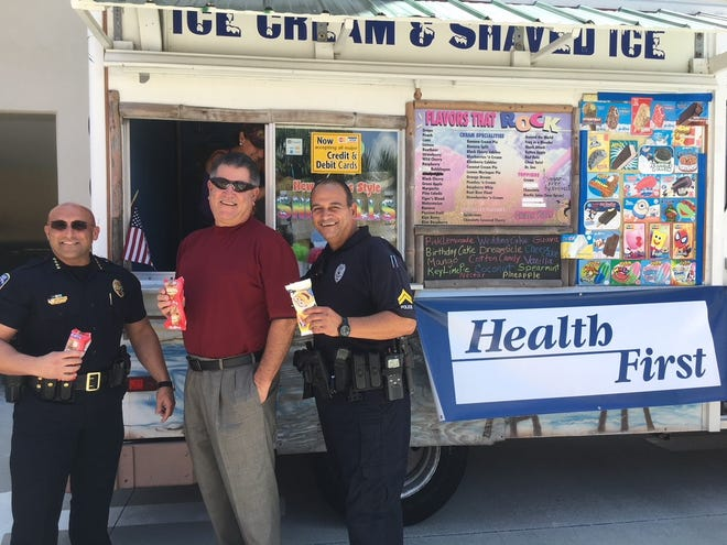 A cool, sweet way to thank Brevard County's first responders. Here are  Cocoa Beach Police Chief Scott Rosenfeld, City Manager Jim McKnight, and Corporal Ezequiel Rodriguez being treated to ice cream by Health First.