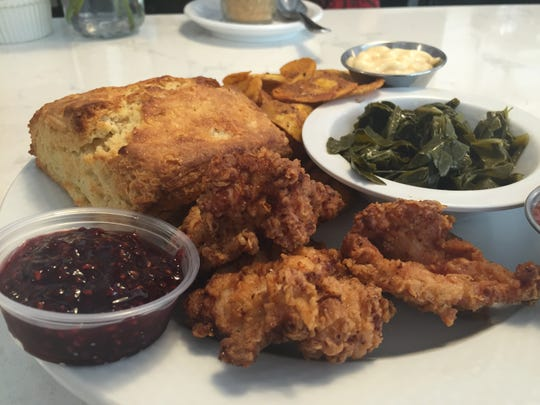 A biscuit, plantains and collard greens accompany a chicken meal at Down Home Kitchen in Montpelier.