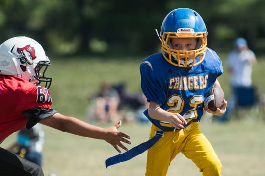 An Essex player runs with the ball during the youth football jamboree at the Palmer Field on Aug. 25.