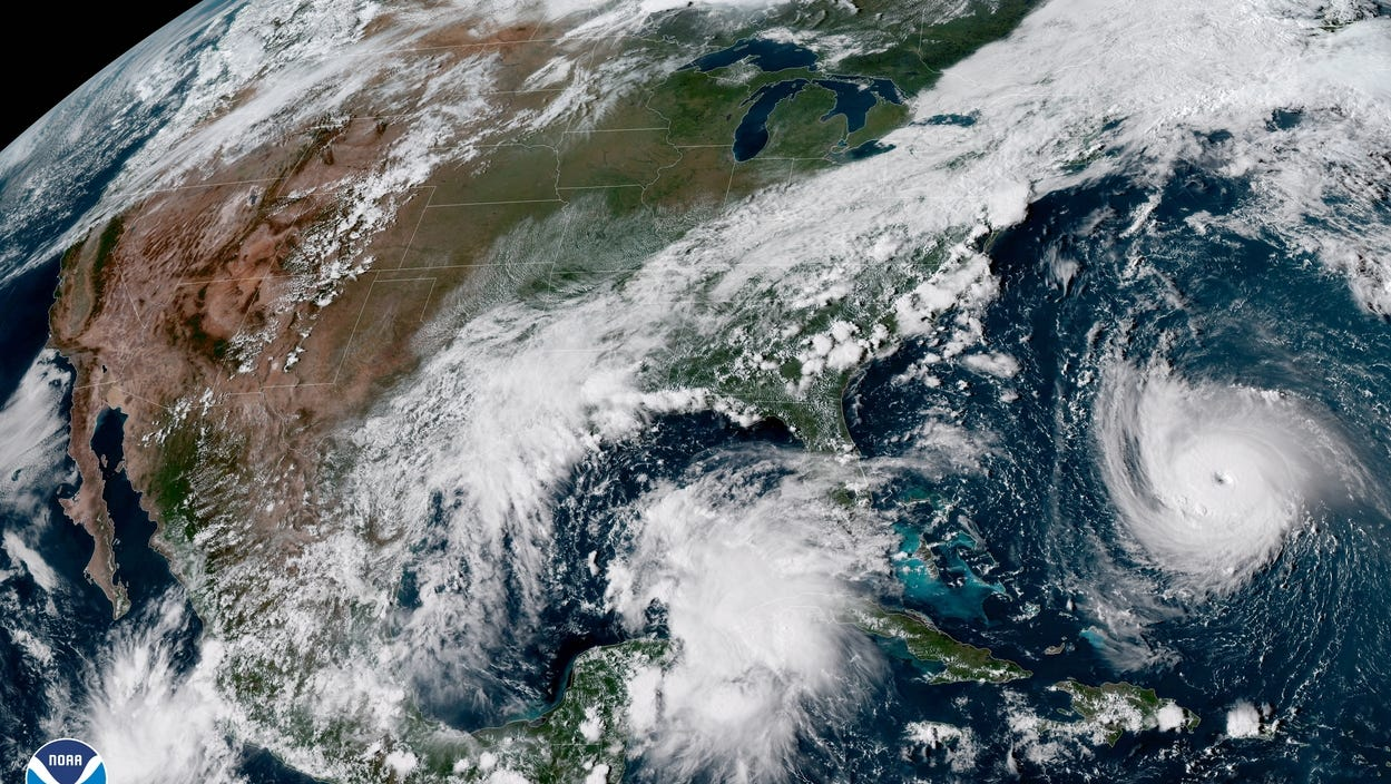 GOES-E satellite imagery showing current tropical activity in the Gulf of Mexico and Atlantic Ocean. Visible is a surface trough extending from the southeastern Gulf of Mexico to the eastern Yucatan Peninsula and Hurricane Florence in the Atlantic.