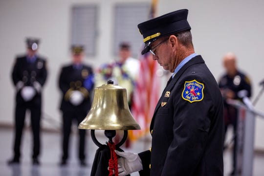 Corpus Christi Fire Captain Michael Pinkerton, a member of the honor guard, rings a bell during the 9/11 Remembrance Ceremony at Del Mar College's FEMA Dome on Tuesday, Sept. 11, 2018. Representatives from the Corpus Christi Fire Department, Corpus Christi Police Department and Port of Corpus Christi Police participated in the event.