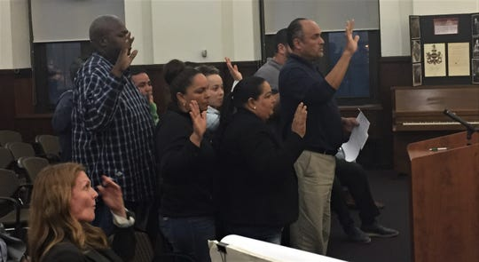 A group of residents unhappy with a planned hotel prepares to speak at Monday's meeting of Camden's zoning board.