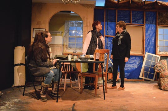 The characters in 'By the Water' must decide, in the wake of Hurricane Sandy, to rebuild their lives in place or let their community go. The play stars, from left, Aimee Theresa, Elizabeth Terry and Susan Dewey and is being staged at South Camden Theatre Company.