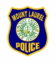 Two building inspectors from Camden have sued the Mount Laurel police department and the New Jersey State Police, claiming they were improperly arrested whie working at a Mount Laurel apartment complex.