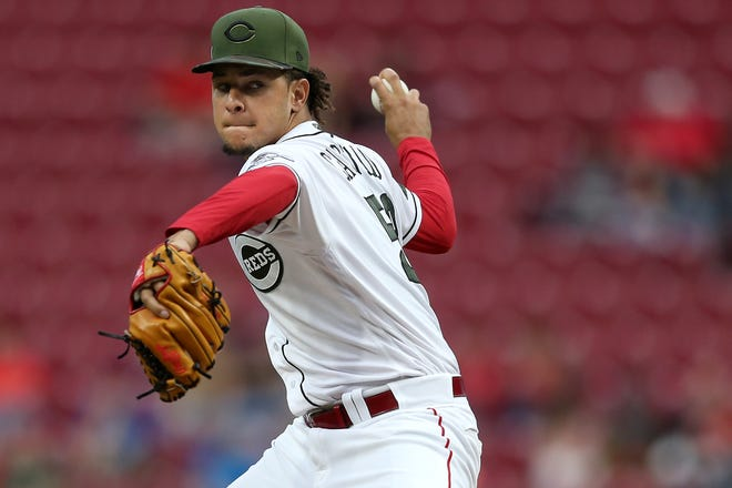 Cincinnati Reds starting pitcher Luis Castillo (58) delivers in the second inning  during a baseball game between the Los Angeles Dodgers and the Cincinnati Reds, Tuesday, Sept. 11, 2018, at Great American Ball Park in Cincinnati.