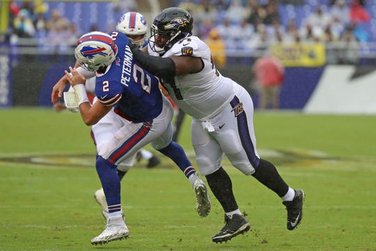 Ravens tackle Michael Pierce (97) pressures Buffalo Bills quarterback Nathan Peterman (2) at M&T Bank Stadium.