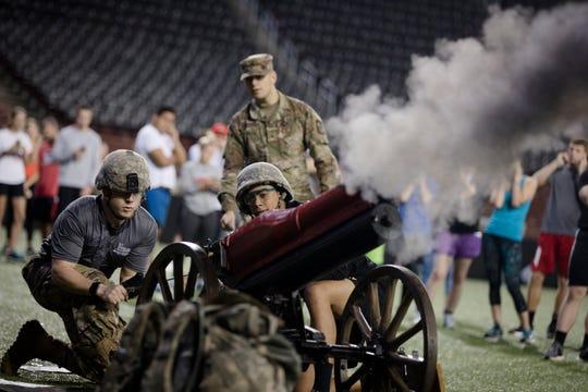 Corey Spoon, University of Cincinnati Army ROTC cadet, fires a cannon during the University of Cincinnati's memorial run at Nippert Stadium honoring 9/11 victims on Tuesday, Sept. 11, 2018 in Cincinnati.