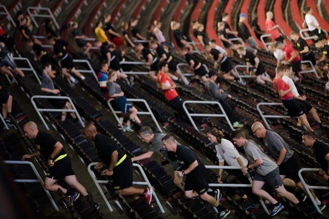 Students and members of the public run stairs during the University of Cincinnati's memorial run at Nippert Stadium honoring 9/11 victims on Tuesday, Sept. 11, 2018 in Cincinnati.