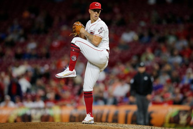Reds relief pitcher Michael Lorenzen winds up for a pitch against the Dodgers at Great American Ball Park on Monday.