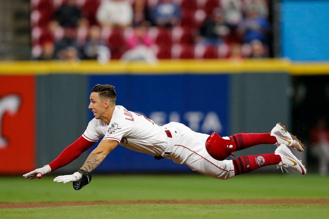 Cincinnati Reds relief pitcher Michael Lorenzen (21) dives in safely for a double in the bottom of the fifth inning of the MLB National League game between the Cincinnati Reds and the Los Angeles Dodgers at Great American Ball Park in downtown Cincinnati on Monday, Sept. 10, 2018.