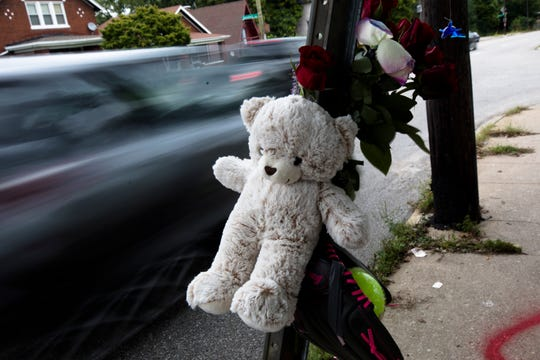 Memorial items are set out at the spot where Gabriella Christine Rodriguez, 15, a Western Hills University High School student, was killed  in a hit-skip crash on her way to school Monday on the 2100 block of Harrison Avenue.