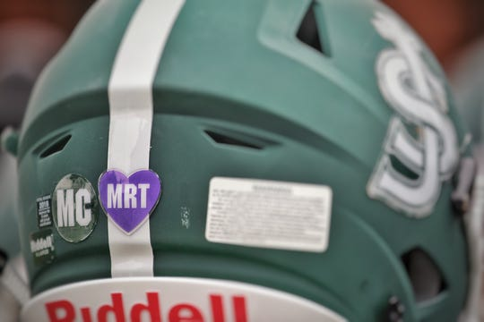 St. Joseph is wearing helmet decals this season honoring beloved former assistant coach Michael Cleary Sr. and Marisa Rose Tufaro