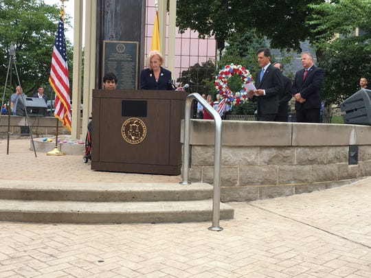 Freeholder Patricia Walsh reads names of some of the 39 Somerset County vicitims of 9/11.