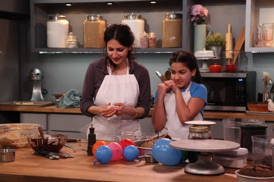"""""""Bake It Like Buddy"""" will showcase mom/daughter team Mary and Izzy Farhat as they battle it out with another family to create a candy-themed cake."""