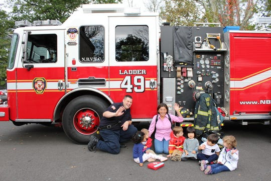 Discovery preschool class at Kangaroo Kids with Firefighter Kevin Calvo and Diana Flores, lead teacher at Discovery Preschool.
