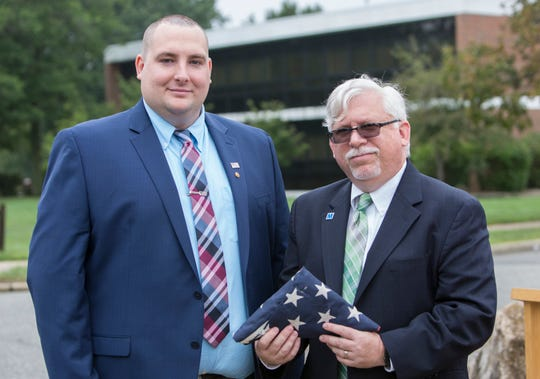 Michael Barany of Woodbridge (left) with Mark McCormick, MCC's interim president, at Middlesex County College's 9/11 remembrance.