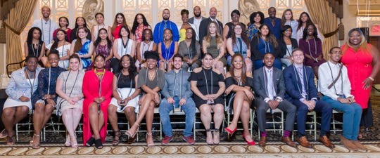 New Berkeley College student members of the National Society of Leadership and Success New York Chapter celebrate their induction during a ceremony held at The Venetian in Garfield, on August 15.