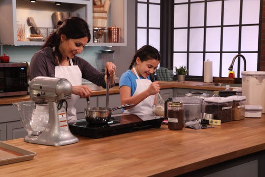 """Bake It Like Buddy"" will showcase mom/daughter team Mary and Izzy Farhat as they battle it out with another family to create a candy-themed cake."