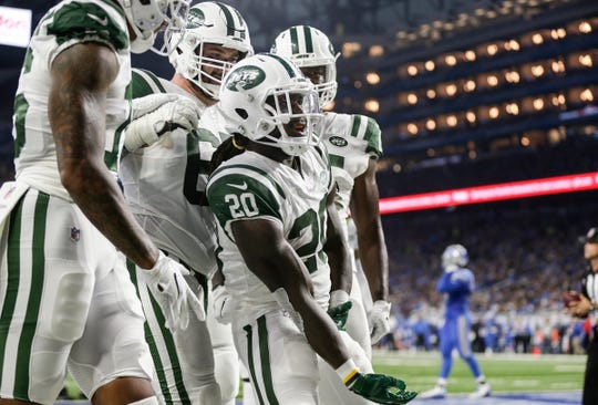 New York Jets running back Isaiah Crowell (20) celebrates his touchdown with teammates during the first half against the Detroit Lions at Ford Field in Detroit, Monday, Sept. 10, 2018.