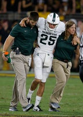 Michigan State punter Jake Hartbarger is helped off the field during the second half against Arizona State, Sept. 8, 2018, in Tempe, Ariz.