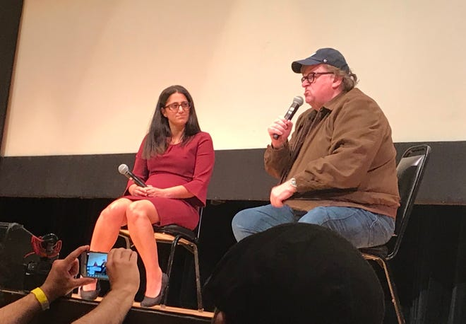 """Dr. Mona Hanna-Attisha and Michael Moore following a screening of his documentary """"Fahrenheit 11/9"""" at the Whiting cultural center in Flint on Sept. 10, 2018."""