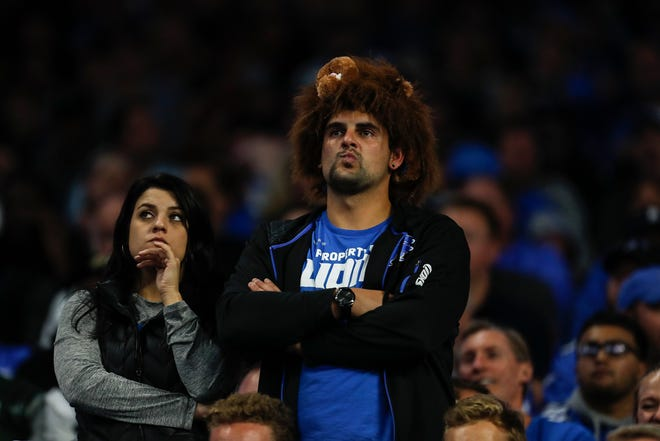Lions fans show their disappointment during the second half against the Jets at Ford Field in Week 1.