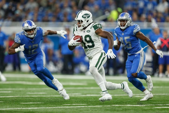 New York Jets receiver Andre Roberts runs against Detroit Lions receiver Bradley Marquez (12) and safety Charles Washington (45) during the first half at Ford Field in Detroit, Monday, Sept. 10, 2018.
