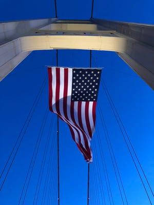An American flag flies from the Mackinac Bridge on September 11, 2018.