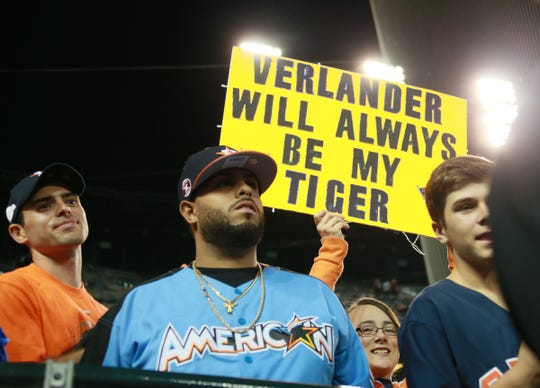 A fan holds up a sign after the Houston Astros beat the Detroit Tigers, 3-2, Monday, Sept. 10, 2018 at Comerica Park.