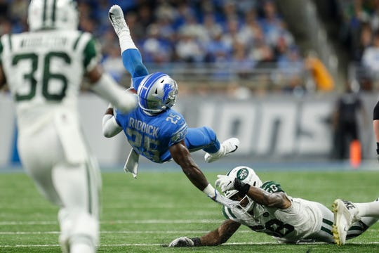 Detroit Lions running back Theo Riddick falls during the second half against the New York Jets at Ford Field in Detroit, Monday, Sept. 10, 2018.