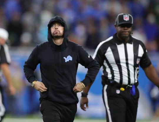 Eminem leaves the field after the coin toss before the Detroit Lions played the New York Jets on Monday, Sept. 10, 2018, at Ford Field in Detroit.