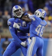 Lions defensive end Ziggy Ansah, left, is questionable to play against San Francisco.