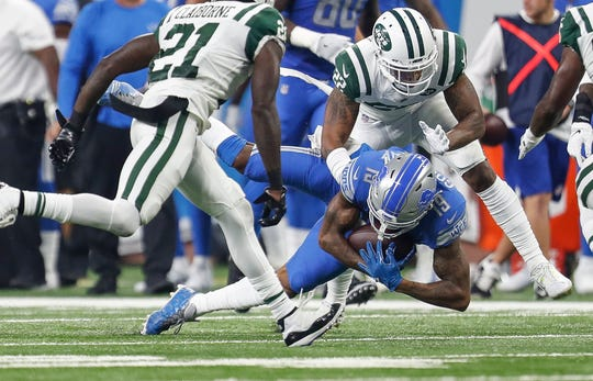 Detroit Lions receiver Kenny Golladay is stopped by New York Jets cornerbacks Trumaine Johnson, right, and Morris Claiborne during the first half at Ford Field in Detroit, Monday, Sept. 10, 2018.