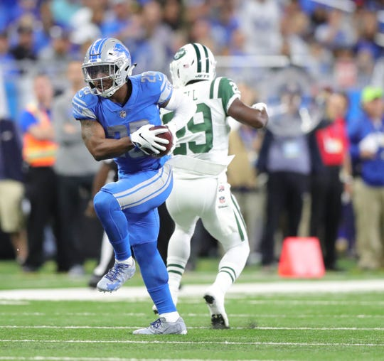 Lions safety Quandre Diggs intercepts a pass against the Jets.