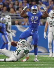 Detroit Lions linebacker Devon Kennard sacks the New York Jets quarterback Sam Darnold during the first half Monday, Sept. 10, 2018, at Ford Field in Detroit.
