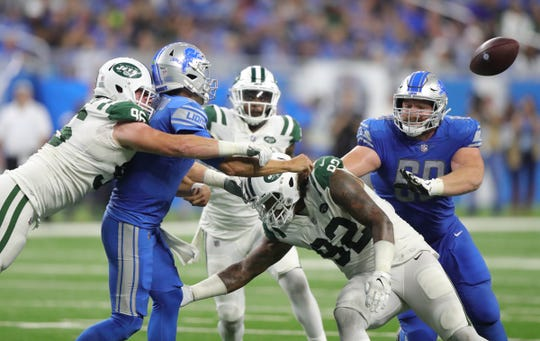 Detroit Lions quarterback Matthew Stafford left the game briefly after this hit by New York Jets defenders during the third quarter Monday, Sept. 10, 2018, at Ford Field in Detroit.