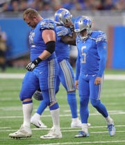 Detroit Lions' T.J. lang, left, and Matt Prater walk off the field during the 48-17 loss to the New York Jets on Monday, Sept. 10, 2018, at Ford Field in Detroit.