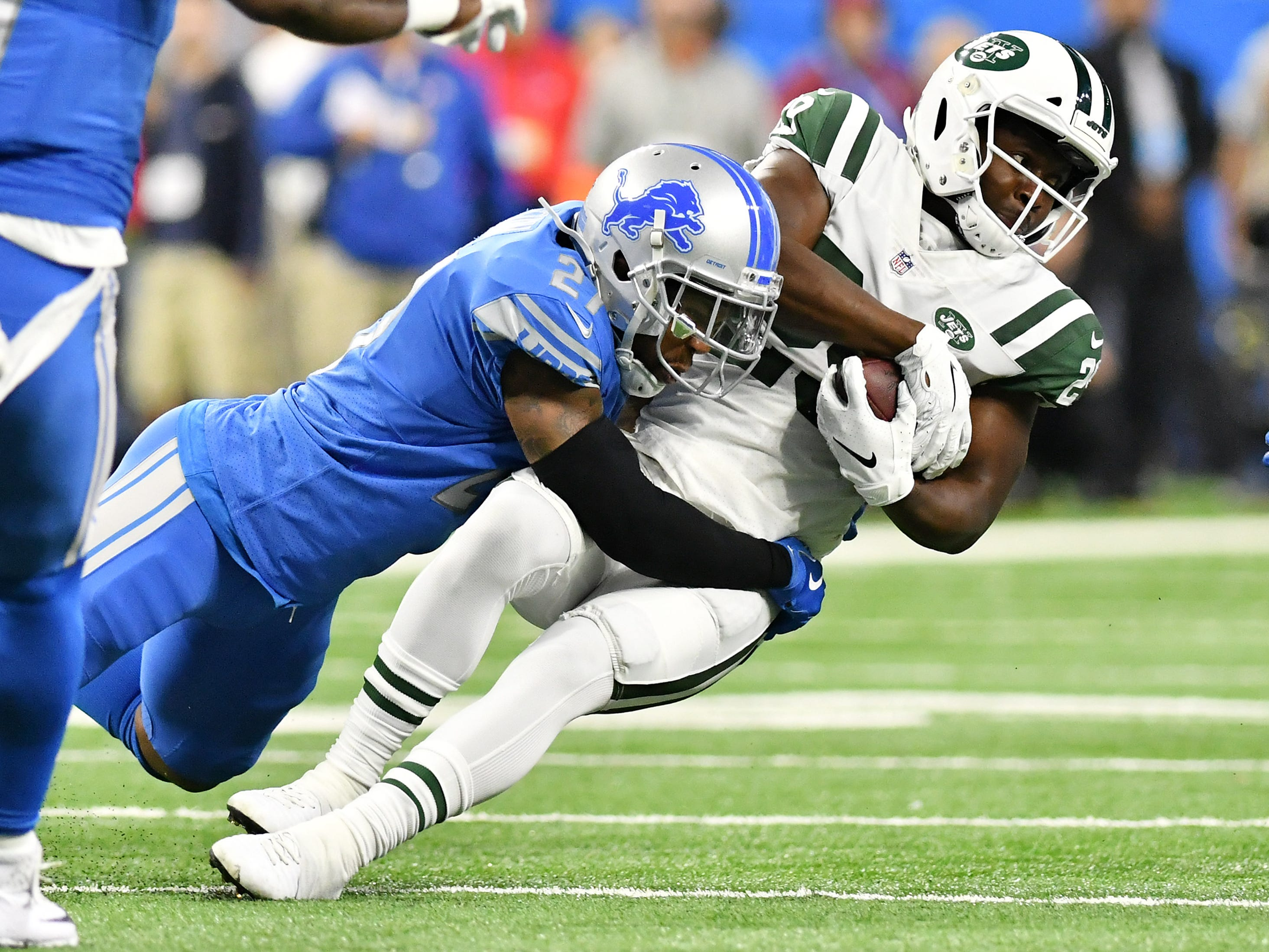 Lions safety Glover Quin tackles Jets running back Bilal Powell in the first quarter.