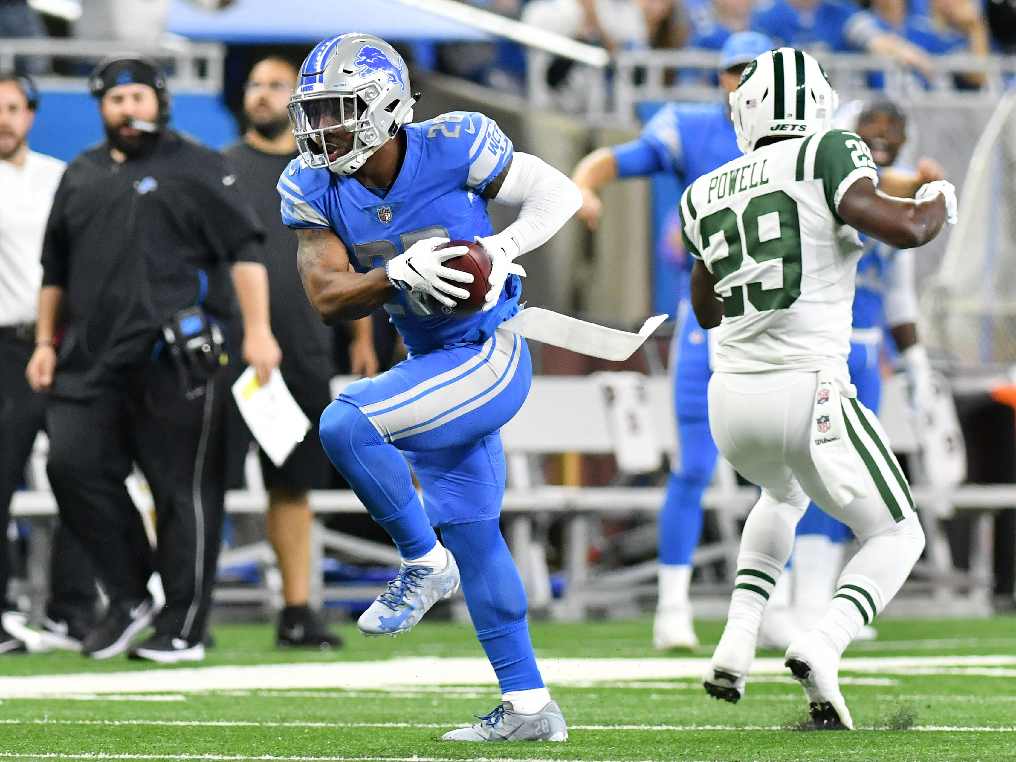 Lions' Quandre Diggs snatches a pass intended for Jets' Bilal Powell and returns it for a touchdown in the first quarter.
