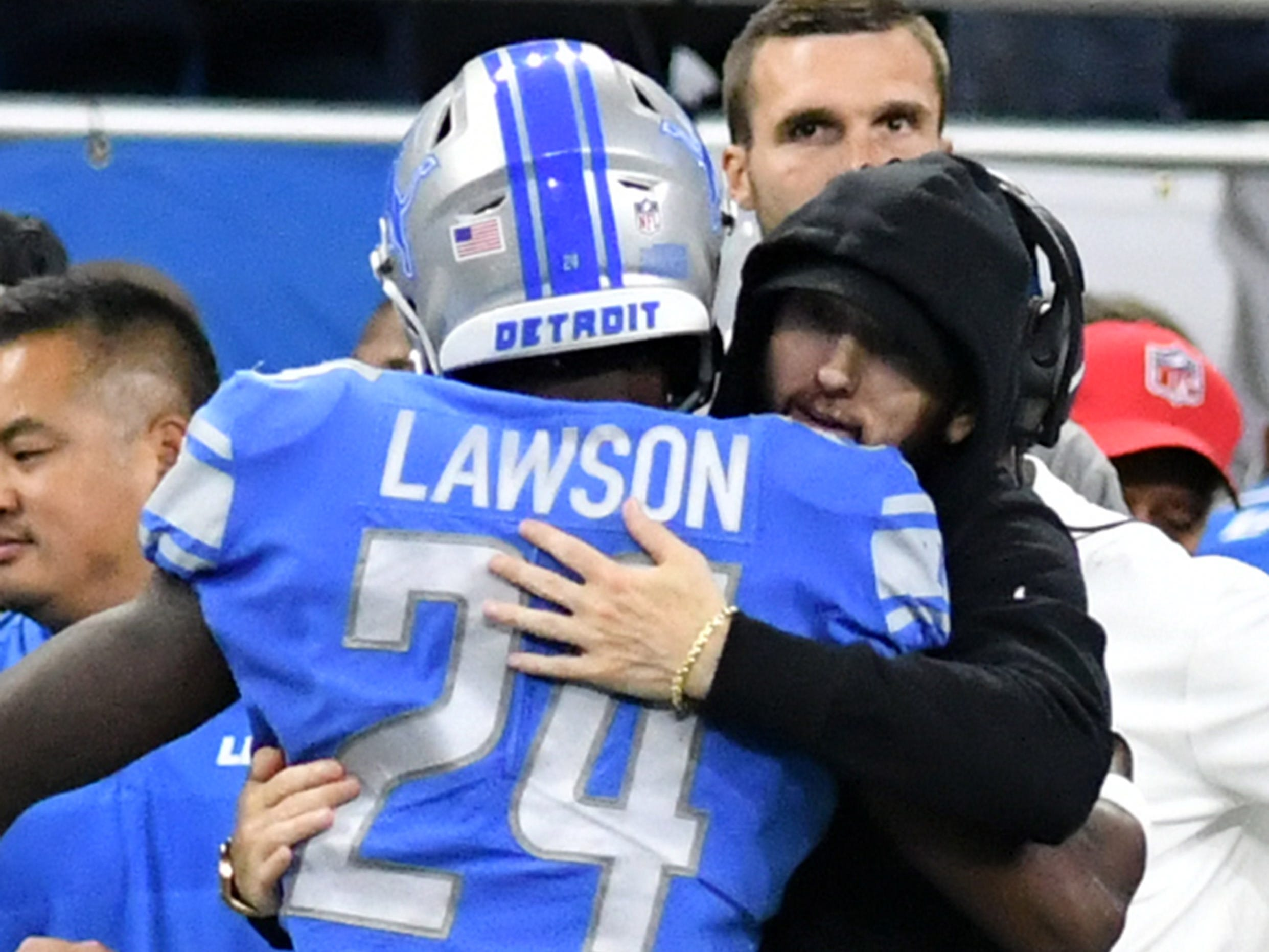 Eminem hugs Nevin Lawson before the game.