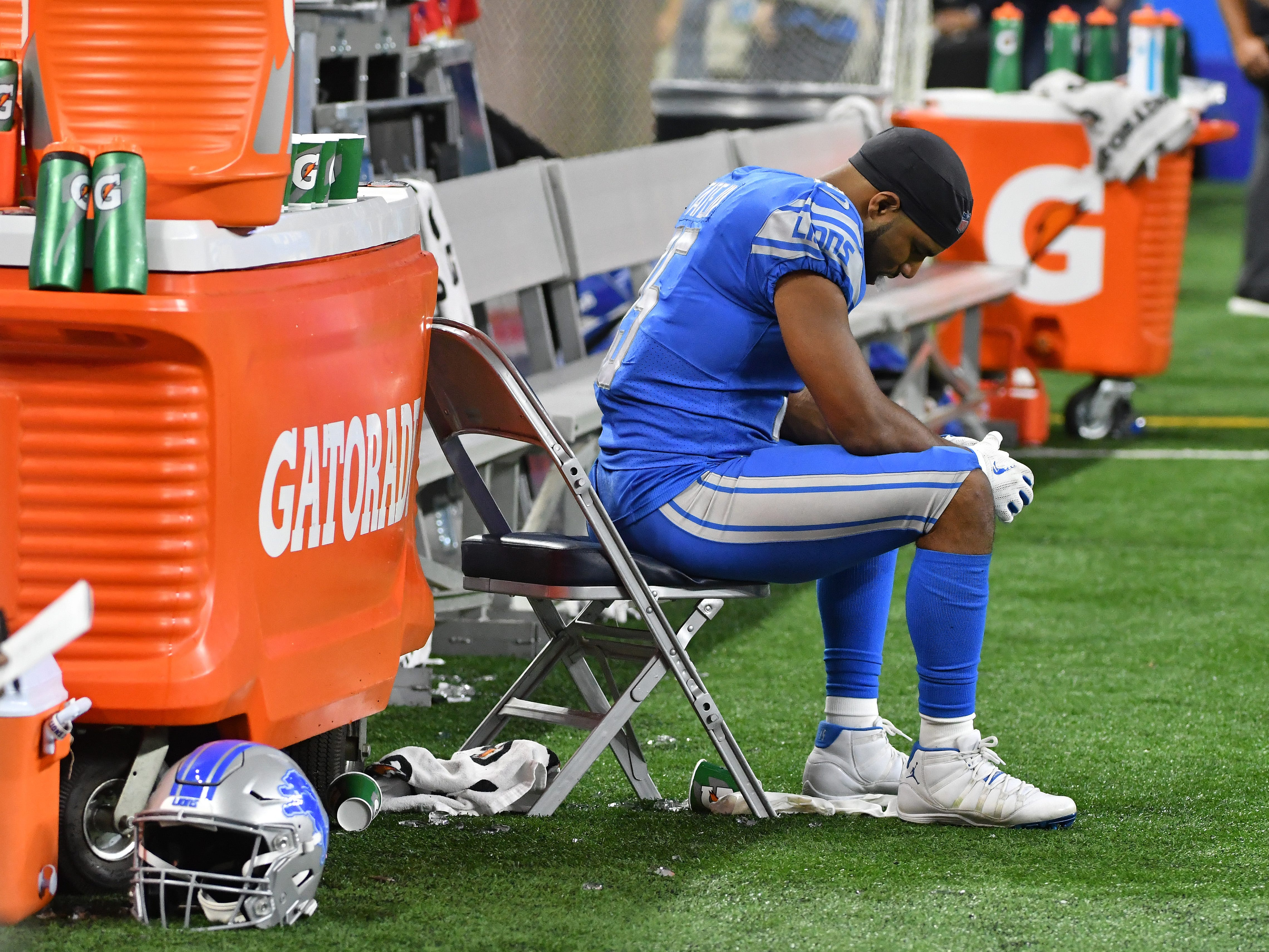 Lions wide receiver Golden Tate sits on the sidelines late in the fourth quarter.