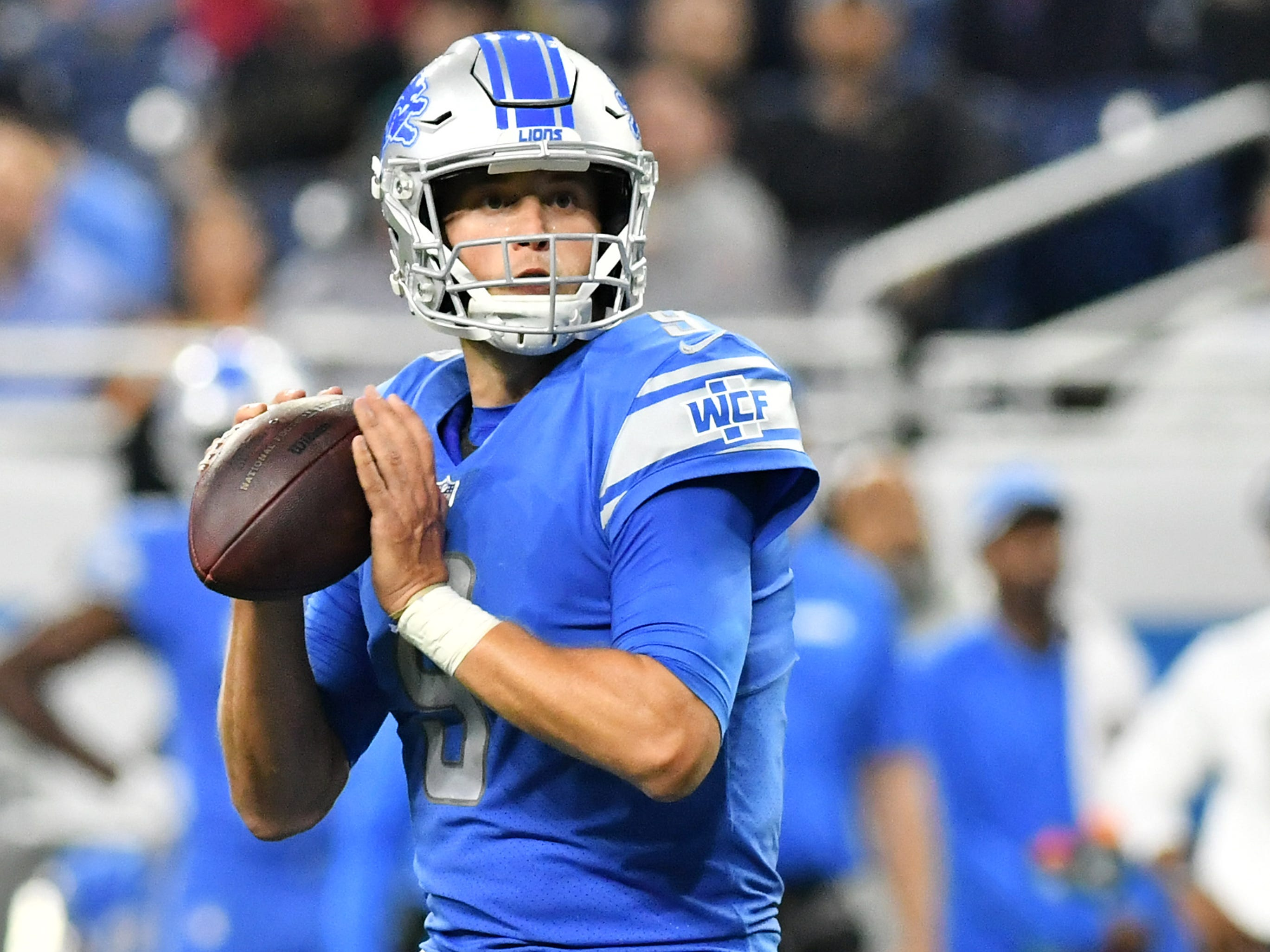 Lions quarterback Matthew Stafford looks to pass the ball in the fourth quarter.