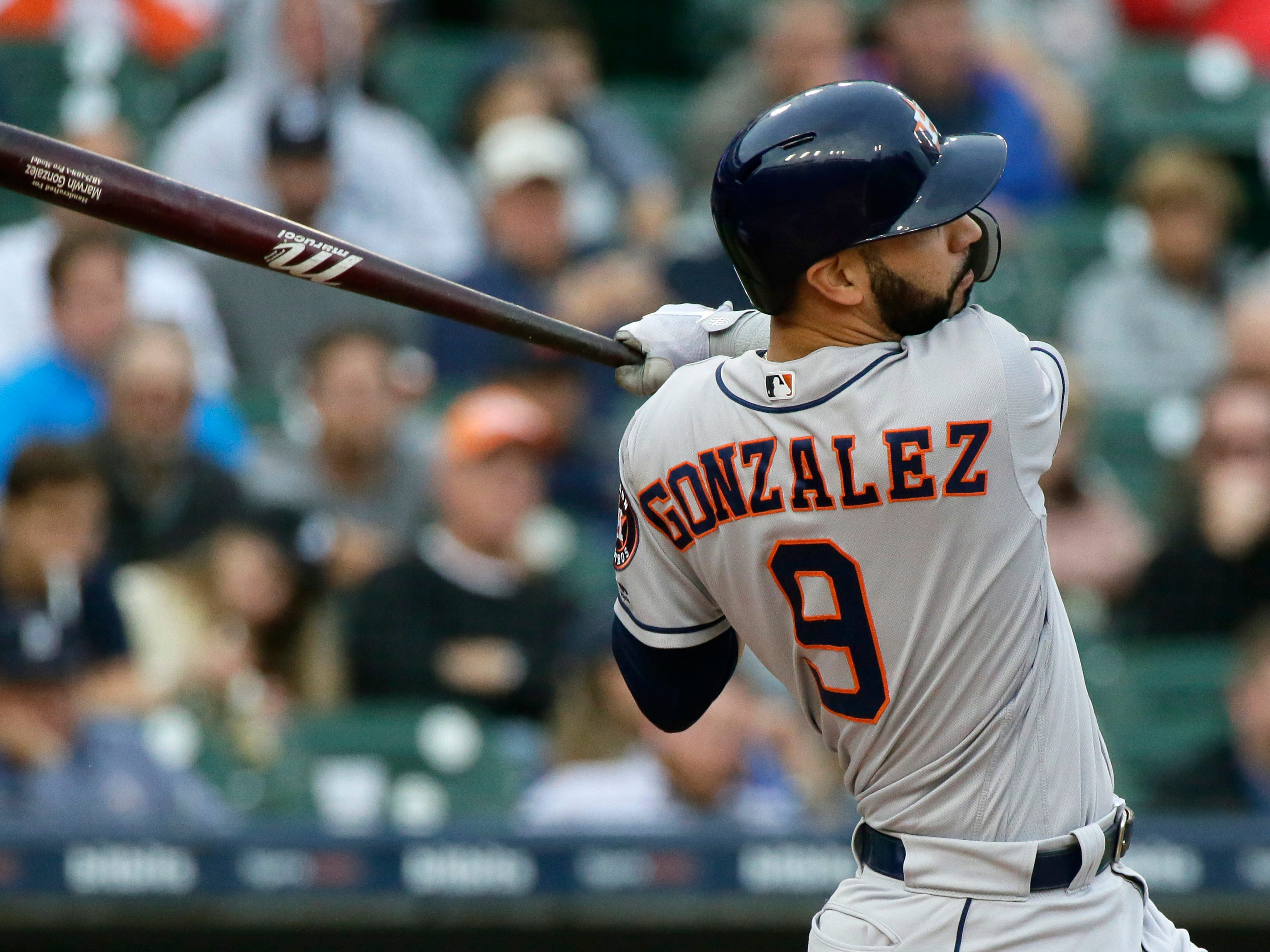 Houston Astros' Marwin Gonzalez singles to drive in teammate Tyler White during the third inning.